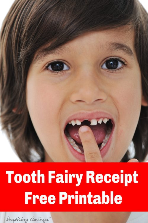Boy missing first tooth -pointing to missing tooth