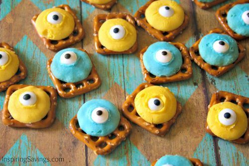adding candy eyes to minion colored chocolates - Pretzel Snack Recipe