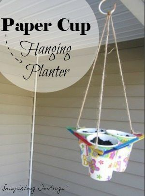 This ingenious planter, made from a paper drinking cups, is a fascinating science project, a lovely hanging planter, and a clever space-saver all in one. It brings seedlings closer to the sun and your family even closer to springtime! Growing plants from seedling can be fun. Perfect craft for toddlers or young kids. #gardening #tips #crafts