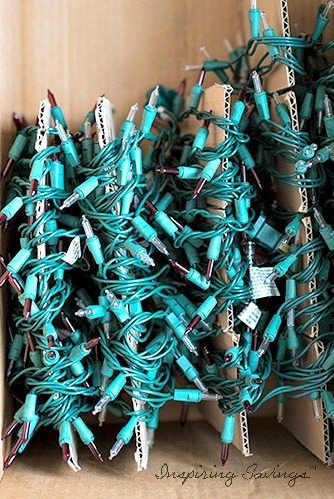 christmas lights wrapped around cardboard and stored in box - organizing for christmas