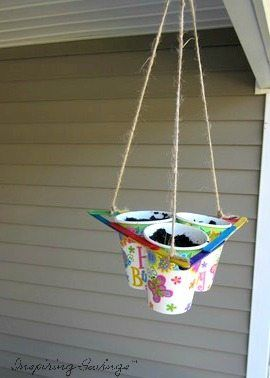 This ingenious planter, made from a paper drinking cups, is a fascinating science project, a lovely hanging planter, and a clever space-saver all in one. It brings seedlings closer to the sun and your family even closer to springtime! Perfect craft for toddlers or young kids.