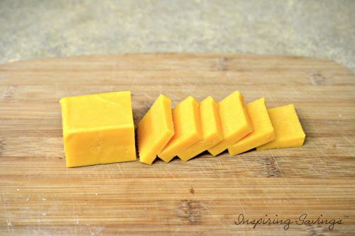 Cheddar Bar Cheese Sliced on Cutting board