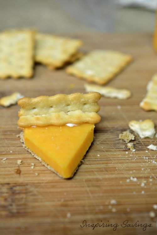 Making Mini Pumpkin Pies out of cheese & crackers