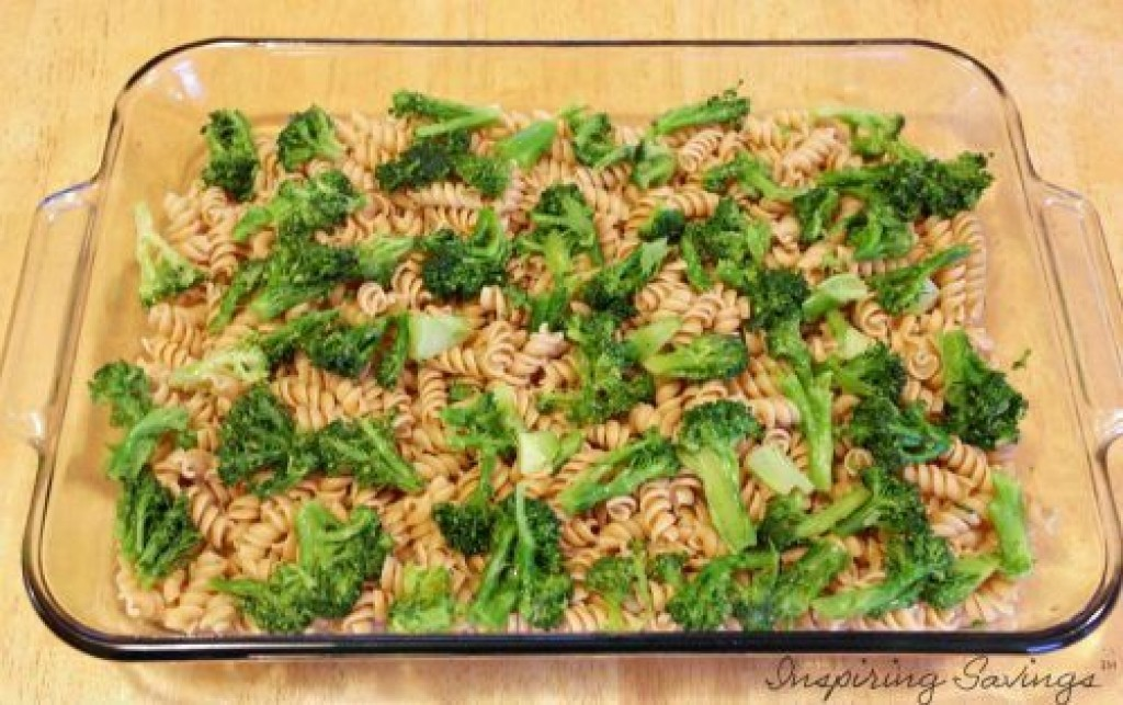 Cooked Pasta and broccoli in glass pan on table
