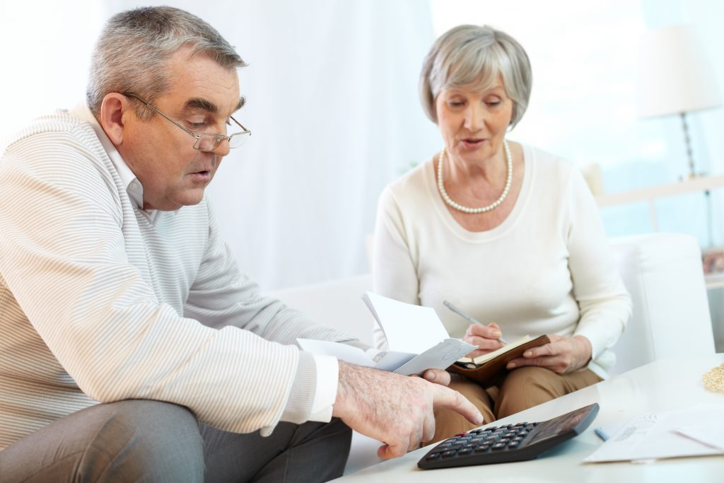 Older Couple working on budget