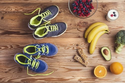Healthy foods on counter next two running shoes