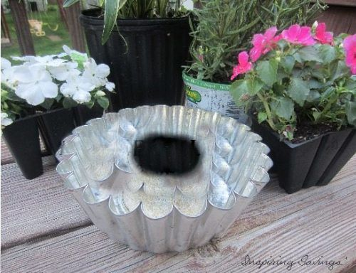 Learn how to transform old pans into planters for your porch, patio, deck and more with this Frugal DIY Plant Holder tutorial. They're the perfect statement piece to plant and display indoor house plants too. You can decorate your entryway, foyer or office with DIY plant holders. Recycling old pans to make a beautiful summertime piece.