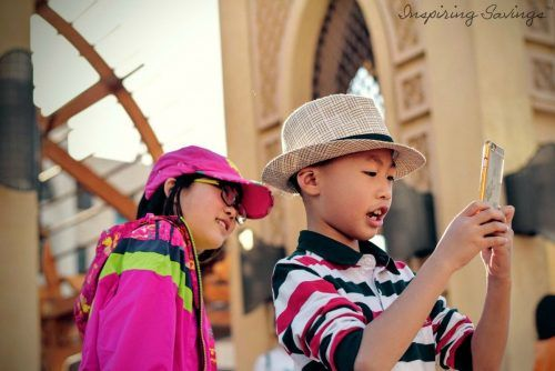 Two children playing pokemon go