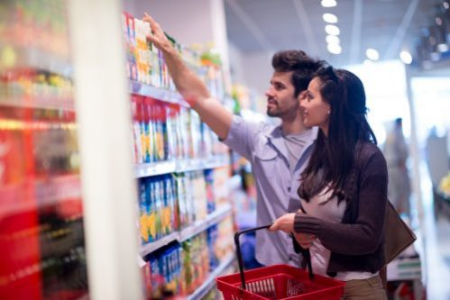 Improving Your Budget has never been easier! - Couple shopping at grocery store