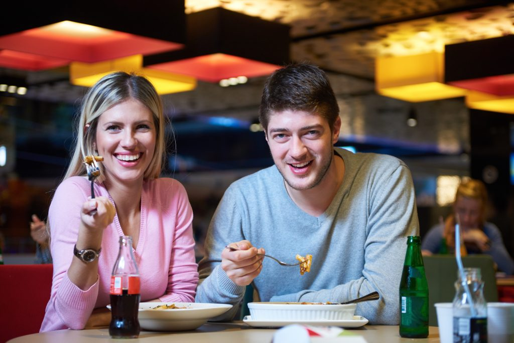 Happy Couple eating out at restaurant