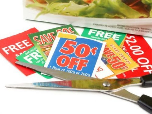 Coupons on countertop with scissors