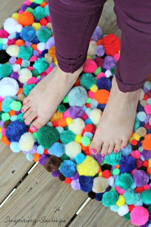 This soft, squishy DIY pom pom rug takes very few skills to create and is a great way to keep your kiddos busy! Everything you need will be pre-made.
