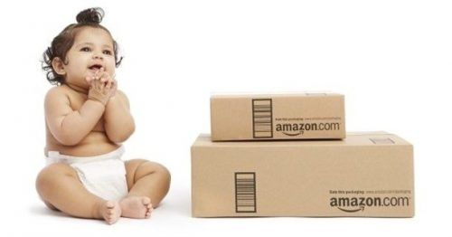 Baby sitting next to amazon boxes