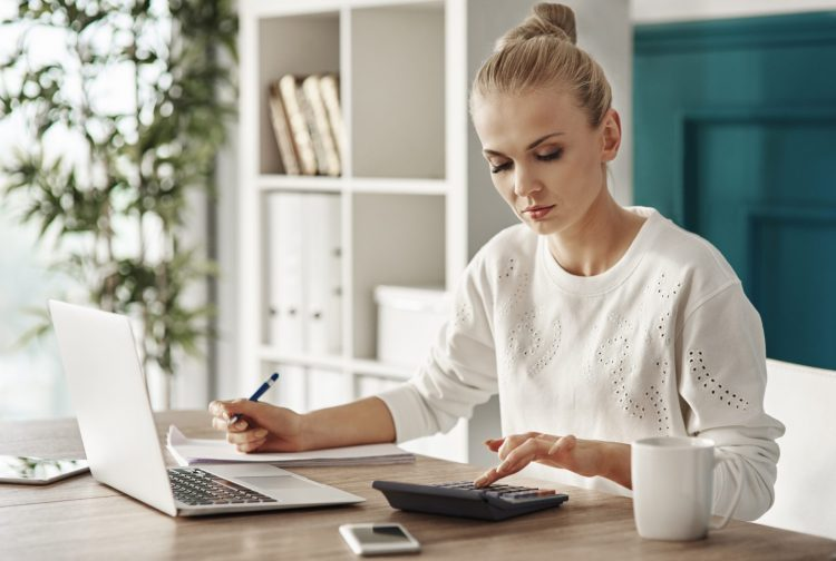 Woman working on budget - Top Budgeting Mistakes You Don't Realize You're Making