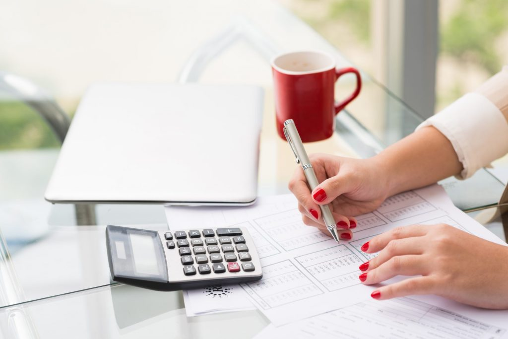 woman working on budgeting mistakes