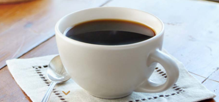 Cup of Coffee on napkin with Spoon - National Coffee Day Freebies