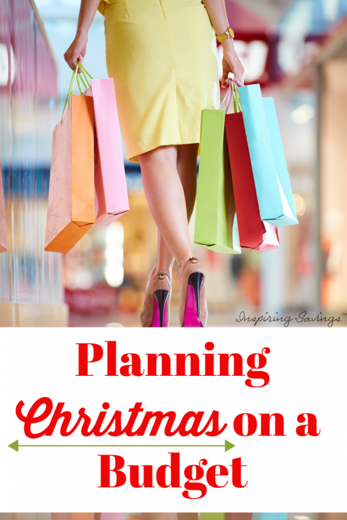"""Woman holding multiple shopping bags - with text overlay """"Planning Christmas on a budget"""""""
