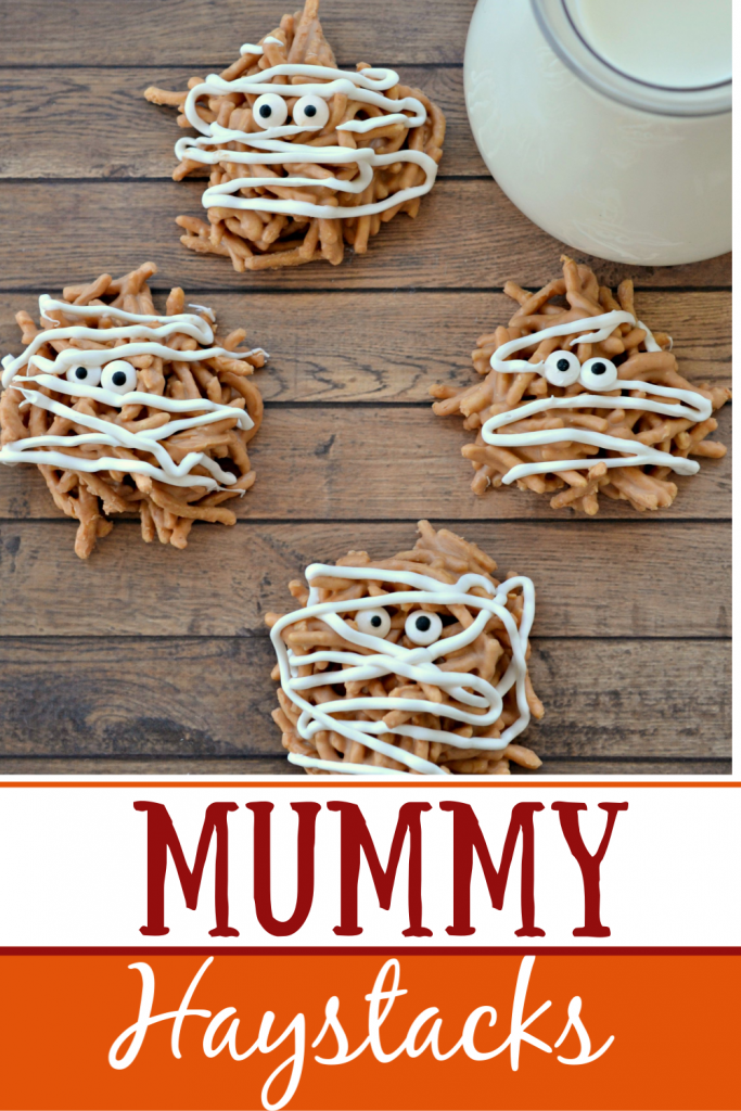 Mummy Haystack cookies on wooden background with a glass of milk