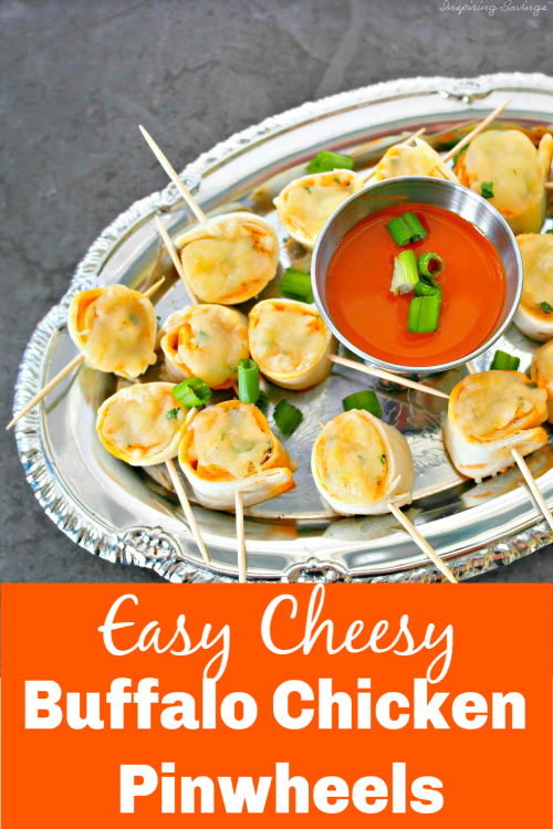 Buffalo Chicken Pinwheels on silver platter - Looking for a buffalo chicken appetizer? This Easy Cheesy Buffalo Chicken Pinwheels is perfect for a party, barbecue, game day or large gathering appetizer. Warm, creamy, delicious and loaded with buffalo wing flavor.