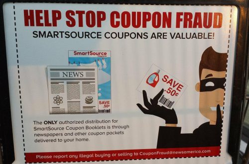 Coupon Fraud Sign Found on Grocery Cart