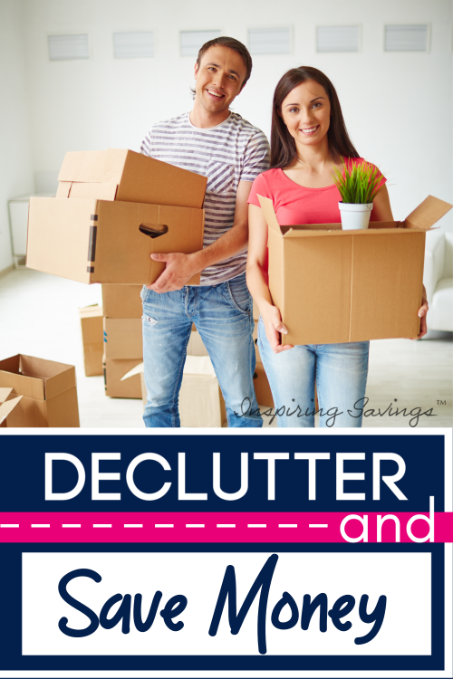 Couple Decluttering their home. Cardboard Boxes in hand