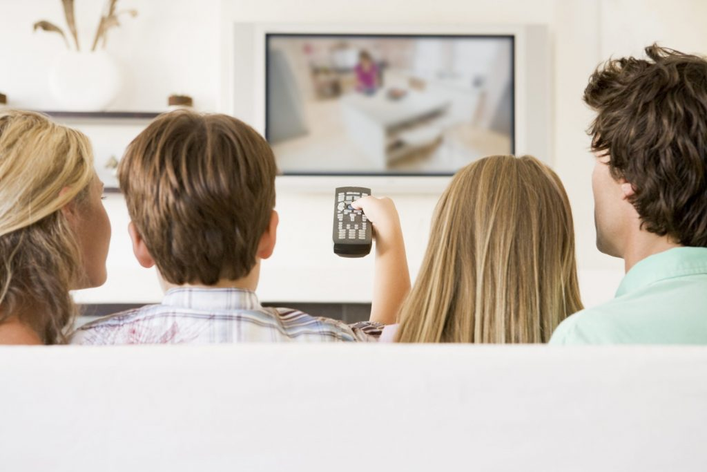 family watching Tv together on couch