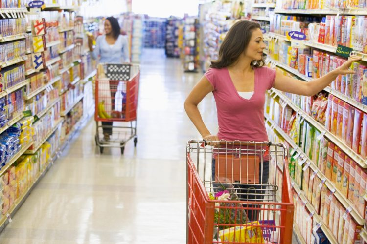 Woman shopping for groceries - Grocery coupons for free