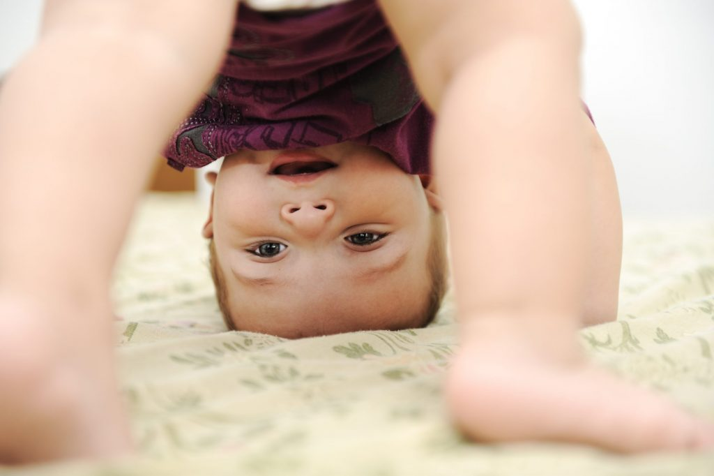Baby Crawling in purple dress