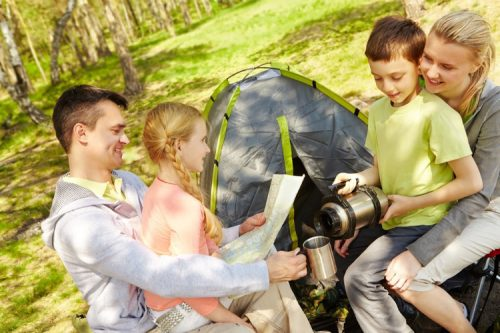 Family spending time together while camping - Kid-friendly campgrounds