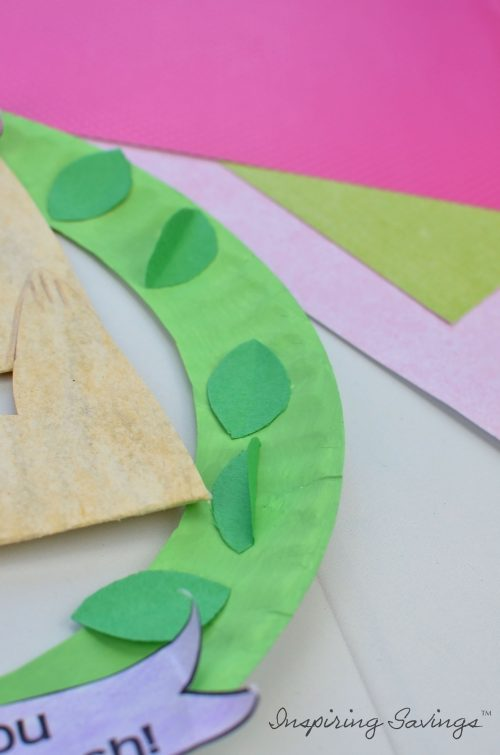 Adding leaves to mother's day card wreath