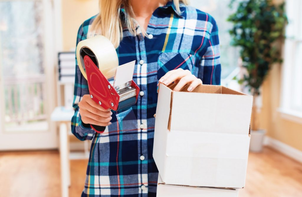 Woman packing up with boxes