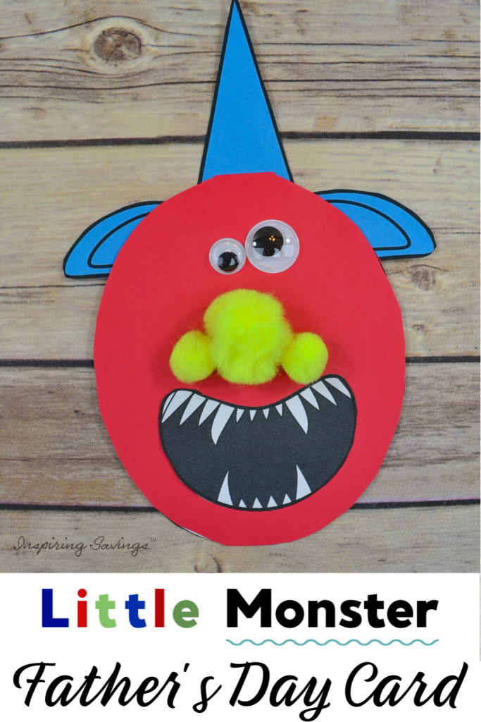 Little Monster Father's Day Card on brown wood background