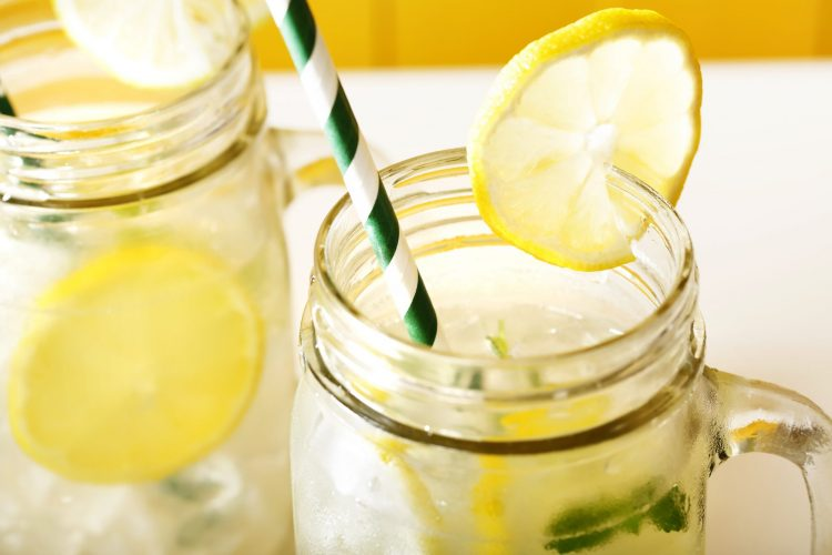Water with lemons in mason jar. - Lemons around the house
