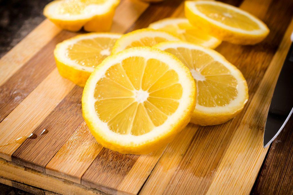 Lemons on cutting board - Use Leftover lemons around the house