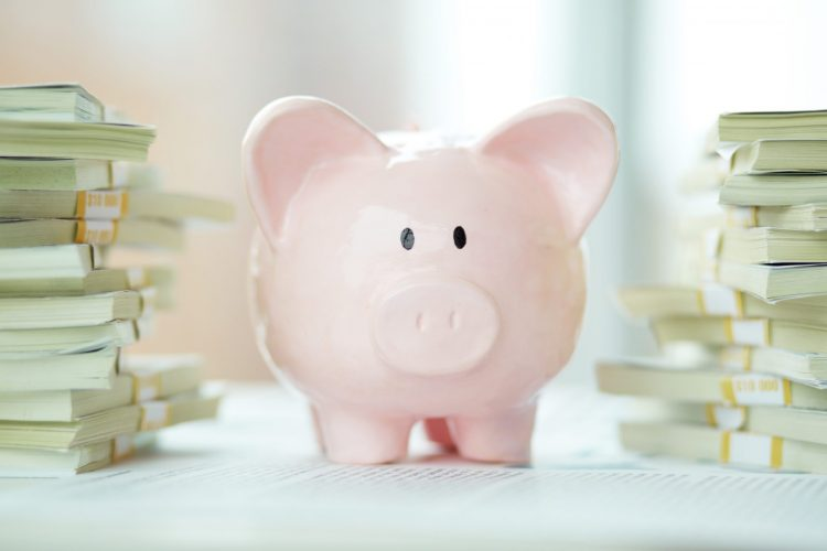 Pink Piggy Bank with money - Smart Ideas to help take control of your money