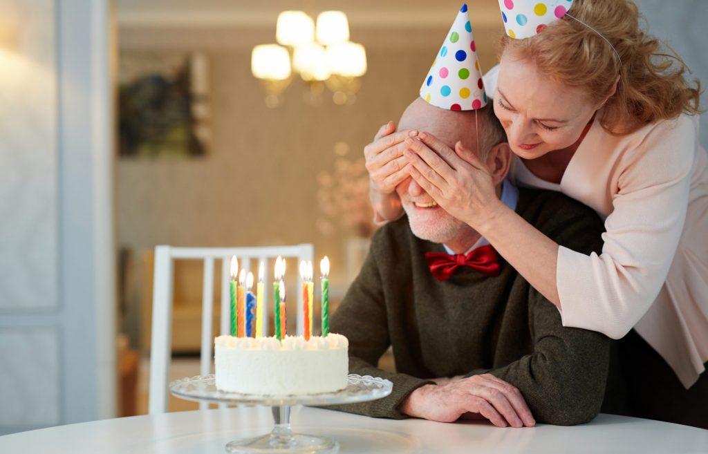 Couple celebrating birthday with a cake