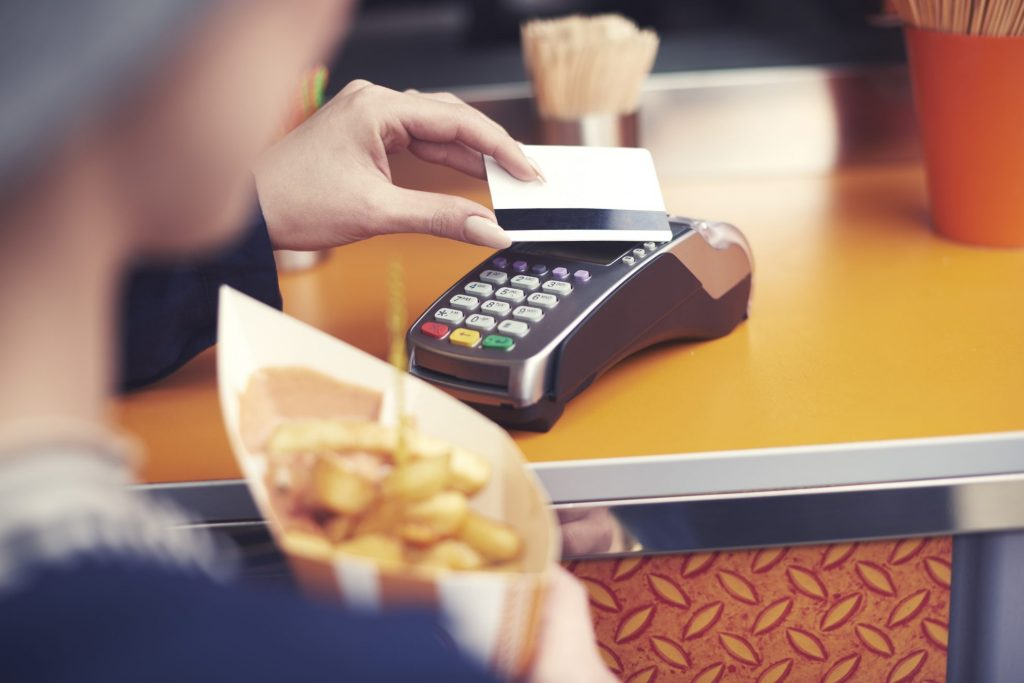 Woman paying for food with giftcard