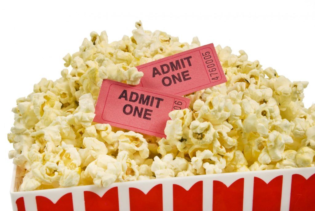 Popcorn for the movies with movie tickets
