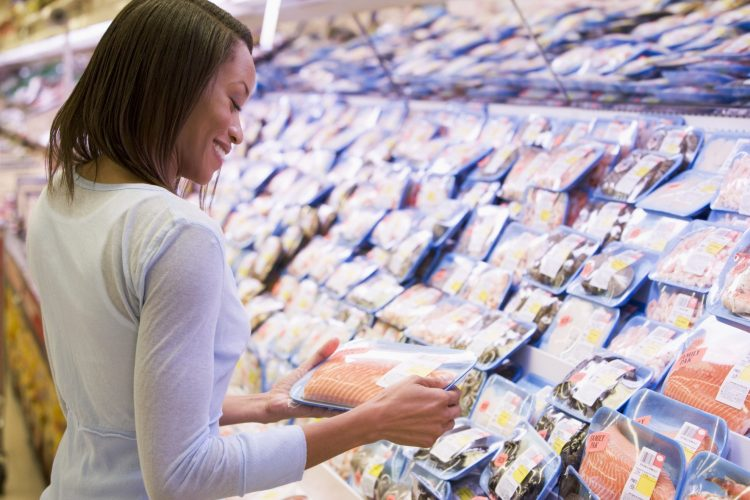 Woman Shopping in the seafood department of supermarket
