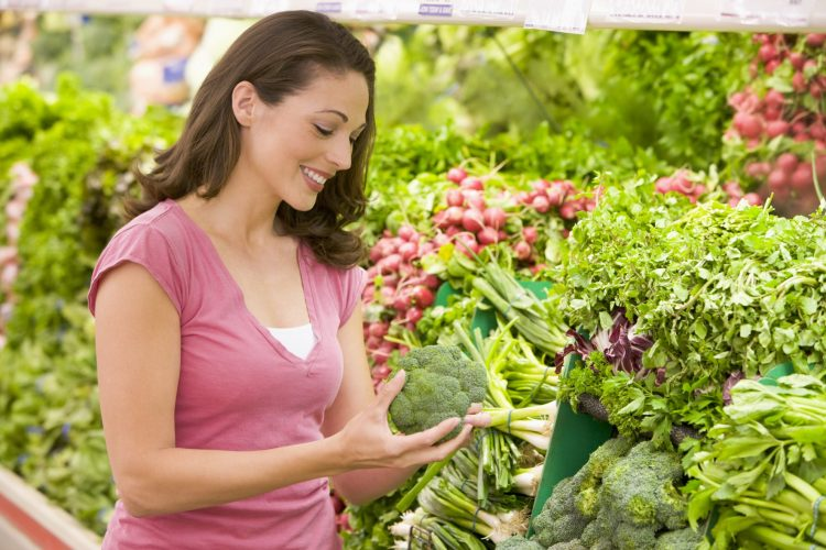 Woman Shopping in the produce department at Supermarket