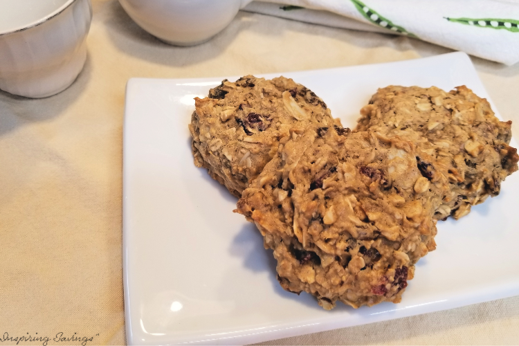 Cranberry Almond Breakfast Cookies on white plate with spotted towel