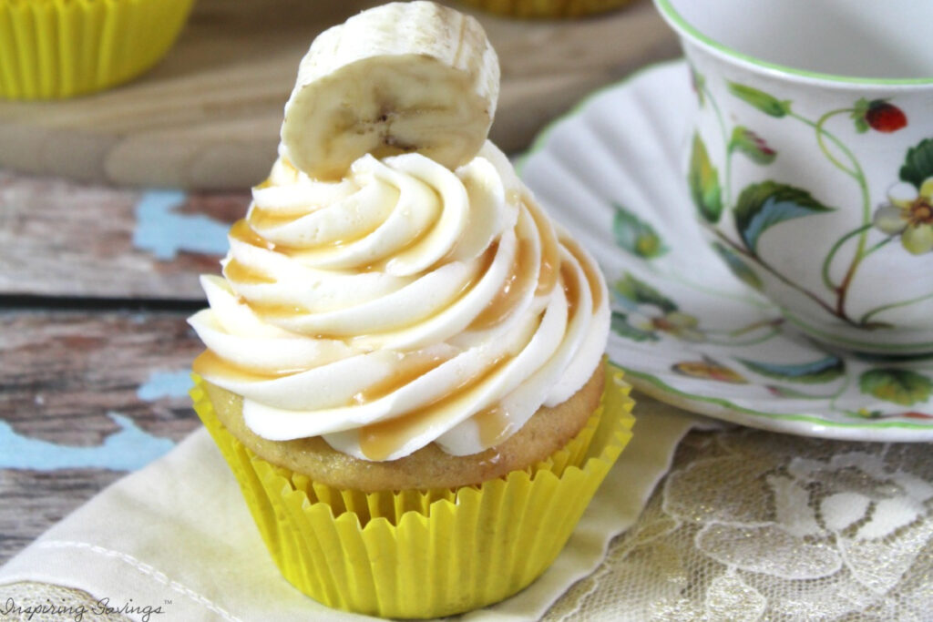 Banana Cupcake with  Salted Caramel Frosting on table with teacup