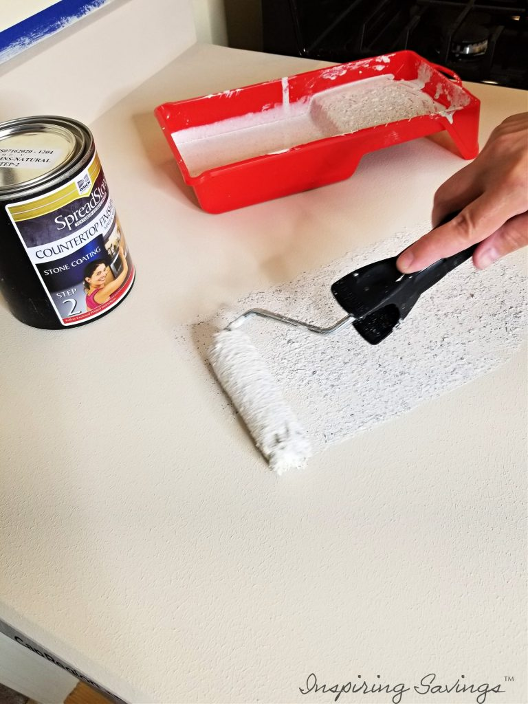 Applying step 2 of refinishing kit - kitchen counter refinishing kit