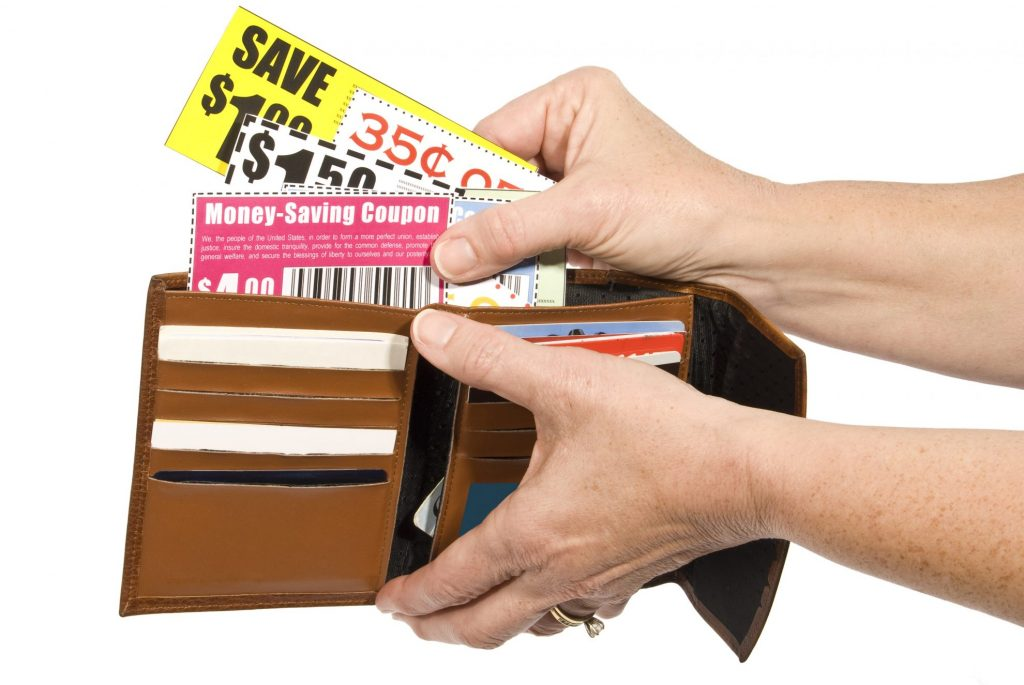 Woman pulling coupons out of a wallet