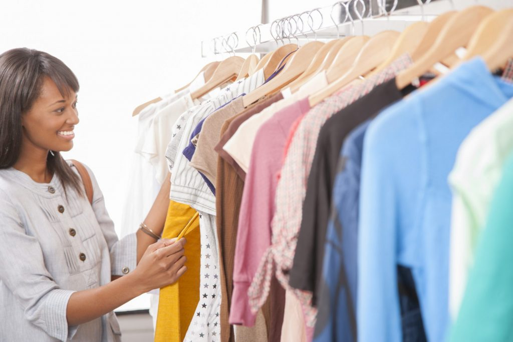 Woman shopping at second hand store.