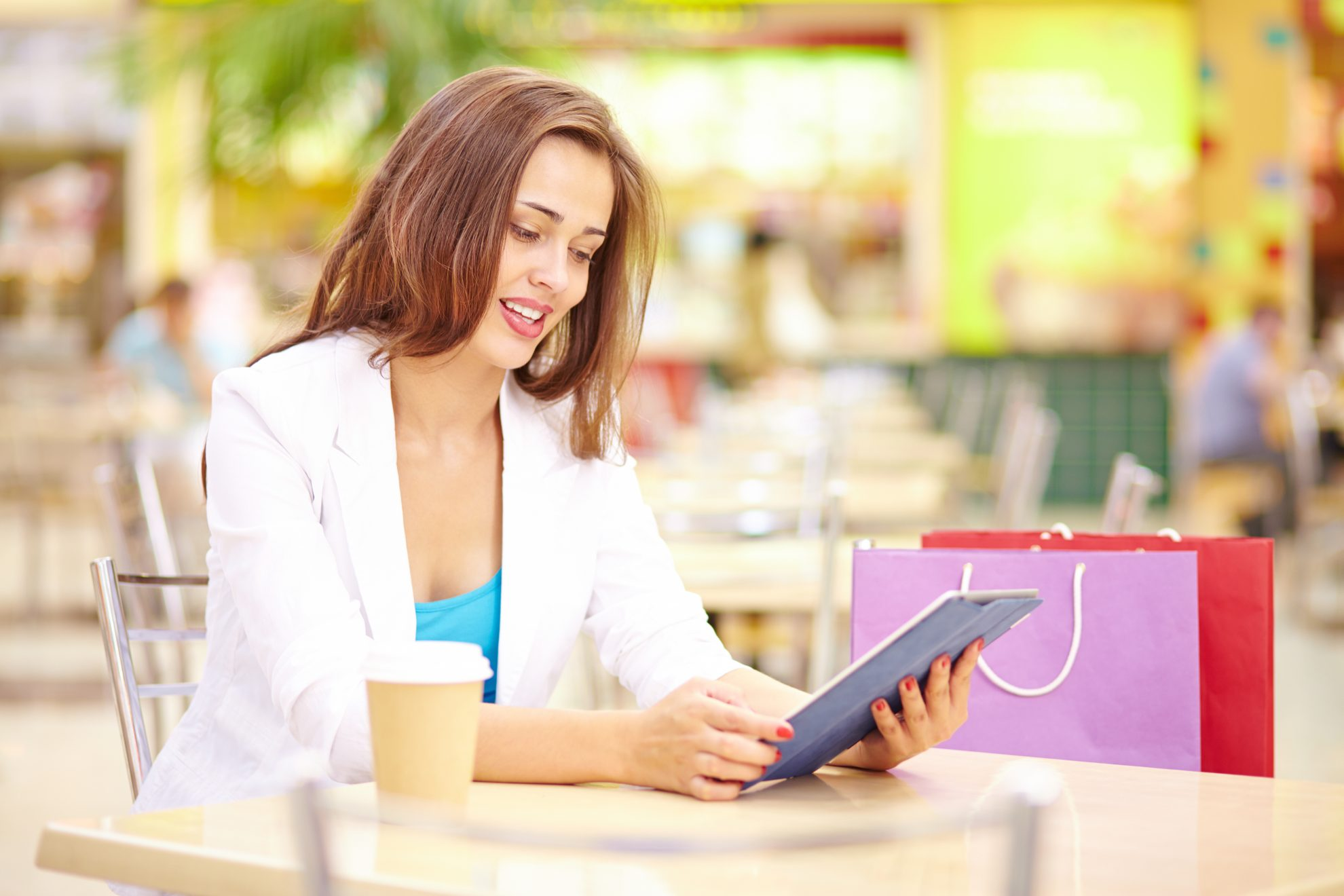Woman shopping and looking for promotional code on tablet