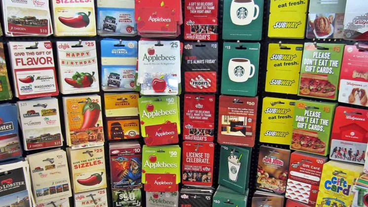 gift cards on display at grocery store