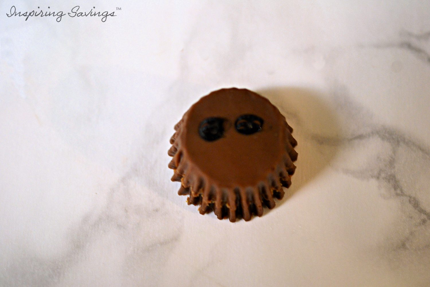 Peanut Butter Cup with black dotted eyes