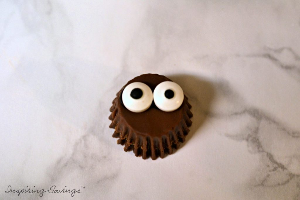 Peanut butter cup with googly eyes added
