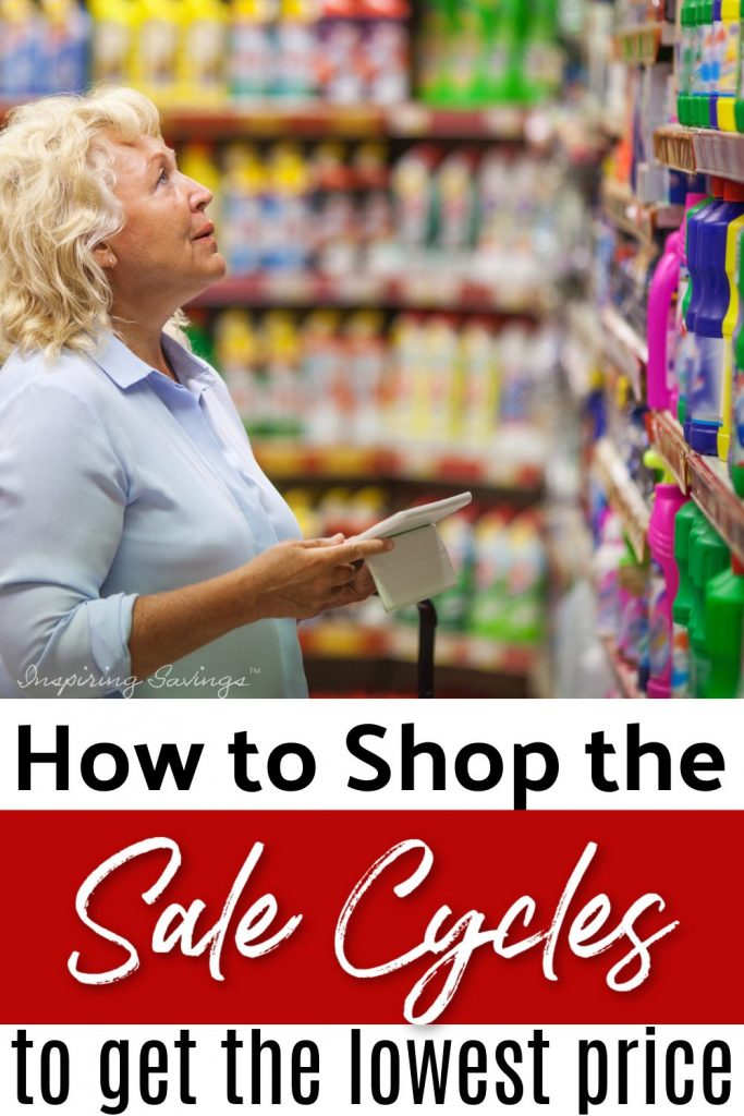 woman shopping in grocery store, checking prices and sale items